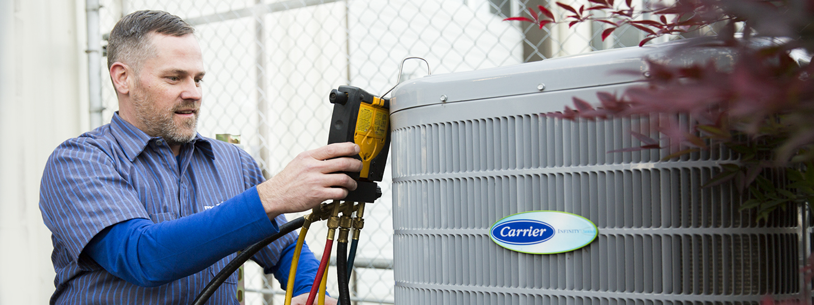 Marshall's Technician performing a Maintenance on a Carrier heat pump